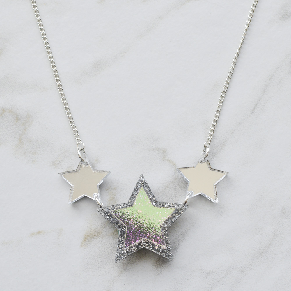 ddb199748 more_vertIridescent & Glitter Star Princess Necklace - Silver